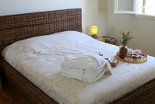 Χenon Estate villa Althea master bedroom rattan double bed
