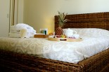 Xenon Estate luxurious villa Althea master bedroom double rattan bed