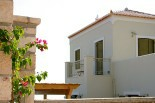 Luxury villas in Greece - Xenon Estate villa Astraea outdoors pergola and top floor master bedroom